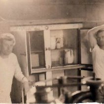 Image of Unidentified Sailors in Front of an Open Cabinet. - 2015.021.006