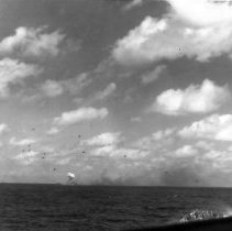 Image of Explosion on Deck of Carrier Under Attack with Escorts - 1982.010.0346