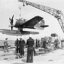 "Image of Seahawk ""Queenie"" lifted by a crane onto BB-55 - 2001.018.0012"