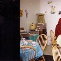 Image of Dr. Mary Ann Tricarico setting up for tea party