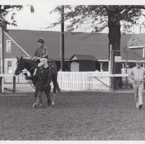 Image of General Assembly with exercise rider in barn area