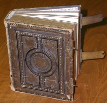"Image of Leather-bound, 5"" x 6"" album with metal clasps, containing 50 CDV's.  Individual CDV's are of Confederate Government personnel and Confederate Generals.  All by Charles Magnus of New York.  - 2001.0703"