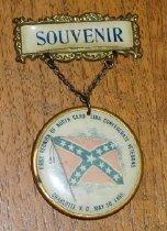 "Image of North Carolina Confederate Veterans pin. [1898] Printed on crossbar: ""souvenir"" Round pin: ""First Reunion of North Carolina Confederate Veterans, Charlotte, N.C., May 20, 1898""   - 2001.0703"