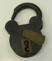"""Image of Large iron padlock, pre Civil War. Brass keyhole and keyhole cover flap. Markings: (crown), """"V R"""" and """"A. Thompson"""" Location of markings: Keyhole cover flap. - 2001.0703"""