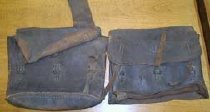 Image of Leather cavalry saddlebags, separated,3 flap straps,1 missing bottom - 2001.0703