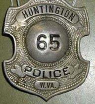 Image of Huntington, WV police badge #65. Nickel silver. - 2001.0703