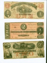 Image of 65 items of Confederate currency, including several printed by the individual Confederate states.  - 2001.0703