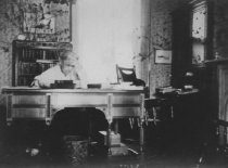 Image of Clara Morrow at her desk, ca. 1910