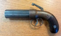 """Image of .36 caliber, six barrels, percussion revolver.  initials """"NM"""" carved into rt. grip. Stampings: (1)Allen & Thurber, Worcester (2)Allens patent Locations of stampings: (1) barrel, (2) hammer """"279"""" inside trigger guard - 2001.0703"""