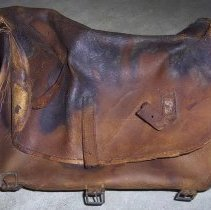 """Image of Saddlebag - Leather saddlebag (valise?). Attached note says, """"Saddle bag from Parson Stearns"""" (presumably referring to Rev. Samuel Stearns.)"""