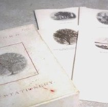 Image of Paper, Writing - Box of writing paper and envelopes. Paper has a selection of photographs of Bedford scenes, including Main Street (The Great Road), First Parish Church, the Two Brothers Rocks, and the Old Oak.