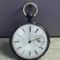 Image of Watch, Pocket - Silver watch, place for monogram. 5 cm round. (No information.)
