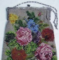 """Image of Purse - Purse, white metal frame with rose design. Beaded design of multi-colored roses. 24.5 x 20 cm. Marked """"Else Fernsler, from Mrs. L. Brown.""""  See B1425, p. 39."""