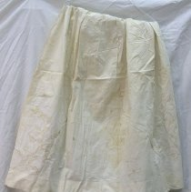 Image of Apron - Woman's apron. White linen apron with gold embroidery in pattern identical to C68.63, with addition of butterfly. Stained.