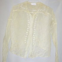 Image of Blouse - Woman's blouse. Sheer, white, with embroidered lace-edged collar and front closure. Embroidery has vine design with heart-shaped leaves. Snap closure.