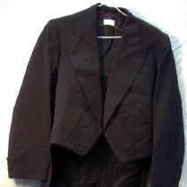 """Image of Coat, Swallowtail - Man's swallowtail(?) coat, black double breasted, three pairs of cloth-covered buttons. Two buttons on sleeves. No outer pockets. Body lined with black fabric; sleeves lined with white-and-purple striped fabric. Tailor's label, """"Farrington, Boston, 194 Washington St."""""""