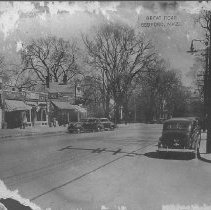 """Image of Postcard - Postcard, """"Great Road, Bedford, Mass."""" Shows Fletcher Block, with brick-front addition, houses to right, automobiles parked along street."""
