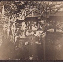 """Image of Photograph - Photo of 5 people in a rowboat, under what appears to be the Old North Bridge. No names, but """"1904"""" noted on the back."""