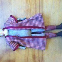 "Image of Doll - Tin head doll, with cloth body and kid arms with porcelain arms & hands. Head has been overpainted, and is stamped ""PATENT"". Kid arms are sewn tied onto added arms. This doll was played with by the donor's family."