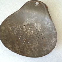 Image of Skimmer - Tin scoop with holes, used to skim curds off the top of milk. Purchased in Bedford at local antique store.