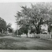Image of Photograph - Looking left on Main Street to Willson Park on left and North Road to right.  First general store (ca. 1801) later moved to Loomis Street.  Photo ca. late 1900s.