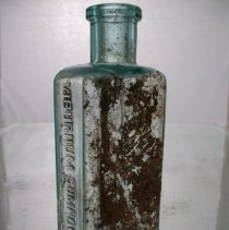 Image of Bottle, Medicine - Hand blown HVC bottle with still visible remnant of a paper label. Purchased on Ebay.