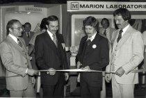 Image of AAPA3.040 - Dan Fox cutting ribbon at AAPA conference, 1977.