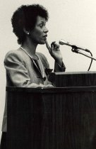 Image of Unidentified African American woman at podium, 1987