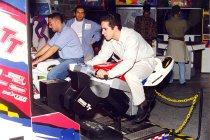 Image of AAPA6.009 - PAs playing arcade racing game, 1997