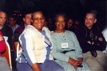 Image of AAPA6.019 - Marsha Woodson (?) with guest, Consuelo Hall, 1997