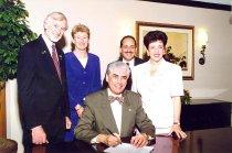 Image of AAPA6.152 - Jerald Breitman signing paper, 1998