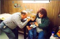 Image of AAPA7.011 - Richard E. Lehr, Jr. examining child with ear ache
