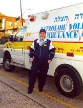 Image of Israel Bochner beside ambulance