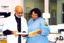 Image of Earl Echard with staff member, 2004