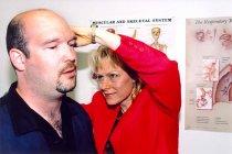 Image of AAPA7.073 - Teresa Nielsen with patient, 2004