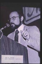 Image of Carl Fasser speaking at podium, undated