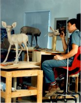 Image of Artist with White-Tailed Fawn