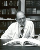 Image of SIC00002 - Eugene A. Stead, Jr. sitting in Library
