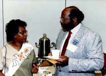 Image of SIC00023 - Mildred Woody and Carl Toney attending reception, 1990
