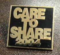 Image of MUC00293 - Care to Share 2004 Pin