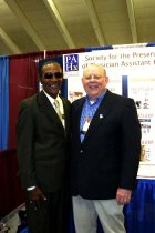 Image of SIC00043 - Reginald Carter with Prentiss Harrison in front of PAHx booth