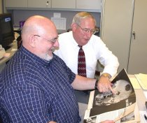 Image of SIC00047 - Vic Germino and Ken Ferrell look through 1966 Look magazine article photos