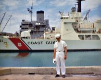 Image of SIC00048 - Ken Harbert in uniform in front of Coast Guard ship