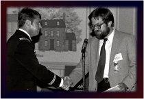 Image of SIC00052 - CWO Phil Clarkson shakes Ken Harbert's hand