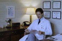 Image of SIC00375 - Paul Hendrix at his desk in his office at Duke University