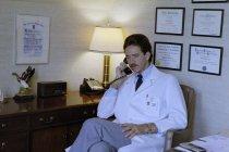 Image of SIC00376 - Paul Hendrix at his desk in his office at Duke University