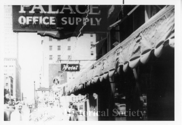 Palace Office Supply Store Awning And Sign On Boston Avenue. Street And  People Can Be Seen In The Background.
