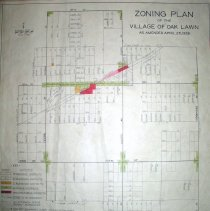 Image of 1938 Map of Oak Lawn - Zoning map of Oak Lawn as amended April 26th, 1938.  It has a key in the lower right corner and green, red, pink and orange markings on it.  There are four hole punches on the left side indicating that it was formerly bound.  The map has been folded.