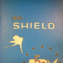 Image of Shield, 1961 - This item is an Oak Lawn Community High School yearbook from 1961.  It has a light blue cover with white and gold writing, and features an image of the United States.