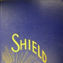 Image of Shield, 1963 - This item is an Oak Lawn Community High School yearbook from 1963.  It has a navy blue cover with a gold image of a rising sun.